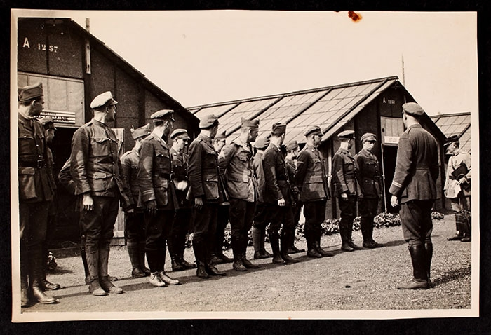 Men with their faces turned left in front of the barracks at the Officers' Training School at Meaux.