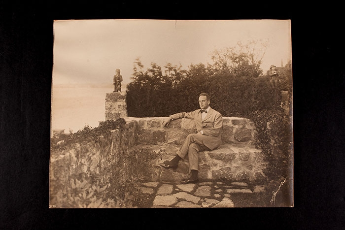 A. Piatt Andrew on the grounds of Red Roof, his home in Gloucester, Massachusetts