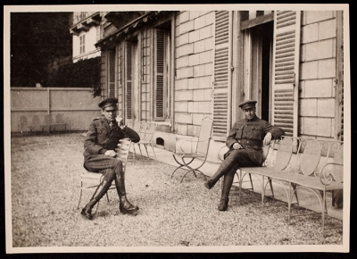 Two men on the terrace at 21 Rue Raynouard