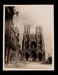 View of the Reims Cathedral, the Grand Hotel, and rubble