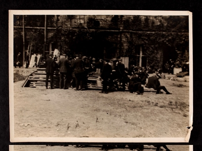 Men gathered around planks of wood