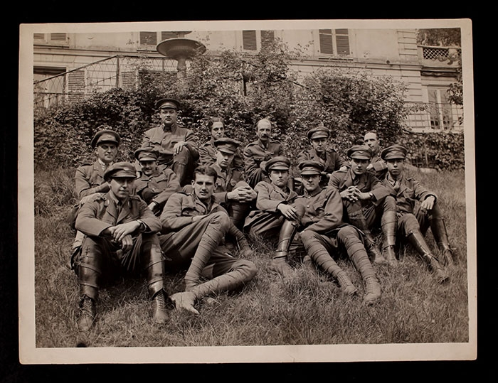 A. Piatt Andrew and Stephen Galatti with group of AFS men on the grounds of the AFS headquarters at 21 rue Raynouard