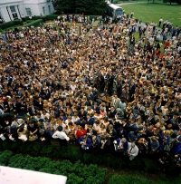 Aerial view of President John F. Kennedy greeting AFS students and reporters.